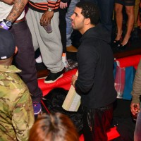 drake-strip-club-money-photos-020-480w