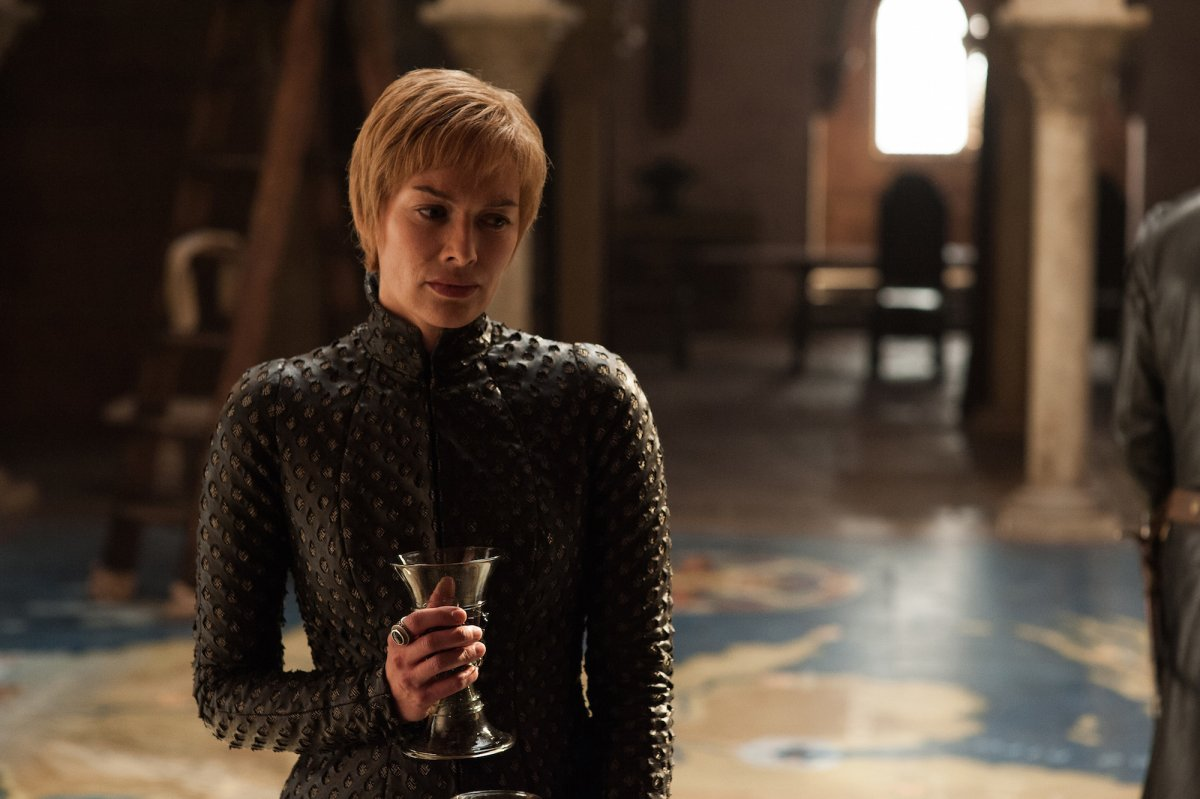 we-see-cersei-glass-of-wine-in-hand-as-usual-standing-on-a-huge-map-of-westeros